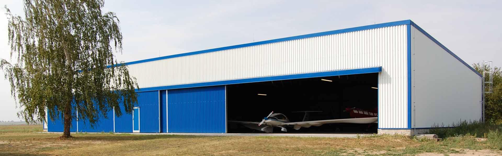 Letecké haly a hangáre - staviame a vyrábame montované oceľové haly LLENTAB